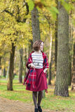 Female Fashion Model Walking in Autumn Forest. Stock Image