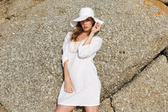 Female fashion model in white sun dress and hat Stock Image