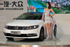Female fashion models and vw in chengdu international auto show. Elegant posture of the female models and the mass brand new CC car in chengdu international auto Royalty Free Stock Images