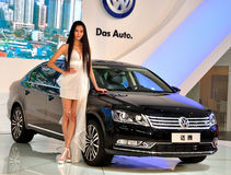 Female fashion models and vw in chengdu international auto show. Elegant posture of the female models and the mass brand new CC car in chengdu international auto Royalty Free Stock Image