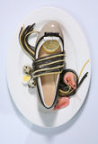Female fashion shoe at the restaurant Royalty Free Stock Photos