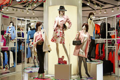 Female fashion shop  interior. View of  fashion clothing store  front,Woman mannequins in fashion clothing retail shop interior Royalty Free Stock Images