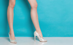 Female fashion. Silver high heels on sexy legs. Stock Images