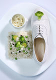 Female fashion white shoe with vegetables Stock Photos