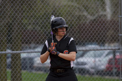 Female Fastpitch Softball Player In The Batters Box Sizing Up The Pitcher