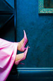 Female feet. In pink shoes royalty free stock images