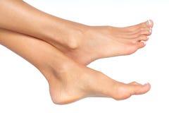 Female feet. Isolated over white background royalty free stock photos