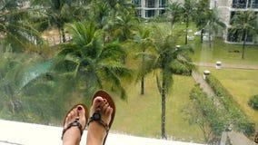 Female feet against tropical scene stock video footage