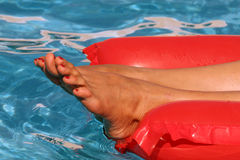 Female feet on an air matress Stock Image