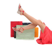 Female feet and bags with purchases 2 stock photos