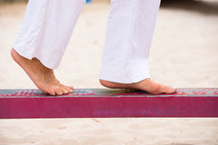 Female feet balancing outdoor Stock Images