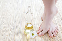 Female feet on the bamboo mat Stock Photography