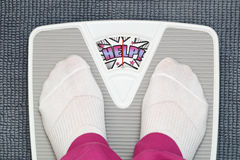 Female feet on bathroom scale Royalty Free Stock Photography