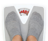 Female feet on bathroom scale Royalty Free Stock Photo