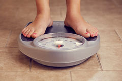 Female feet on a bathroom scale Royalty Free Stock Image