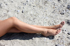 Female feet on the beach Stock Photos