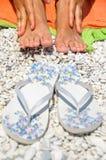 Female feet beach flip flops Royalty Free Stock Photography