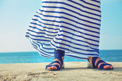 Female feet in billowing dress Stock Photography