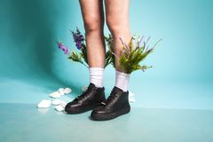 Female legs in black shoes and white socks with flowers stock photos