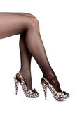 Female feet in black stockings and shoes. On a high heel Stock Image