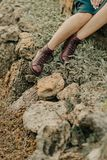Female feet in brown shoes Stock Image