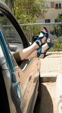 Female feet of car Windows Royalty Free Stock Image
