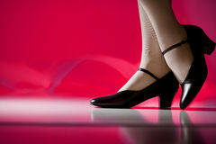 Female feet in character shoes. Pink background, character shoes on woman Royalty Free Stock Photo