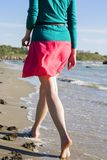 Female feet close-up walking at the seaside Stock Images