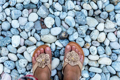 Female feet closeup of pebbles. Walking on pebbles close up of female feet Stock Photos