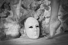 Female feet dancing above a mask Royalty Free Stock Photos