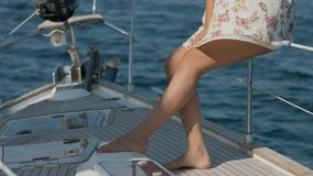Female feet on a deck of yacht stock video