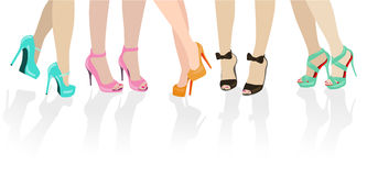 Female feet in different shoes Royalty Free Stock Images