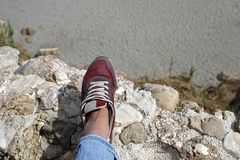 Female feet on the edge of the cliff. Danger situation Royalty Free Stock Image