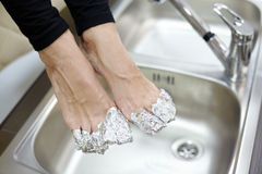 Female feet with fingers wrapped in foil. Stock Photos