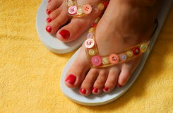 Female feet and flip-flop Royalty Free Stock Photos