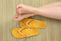 Female feet and  flip-flops Royalty Free Stock Images