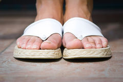 Female feet with flip-flops. Close up Stock Images