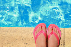 Female feet with flip flops. By the pool stock image
