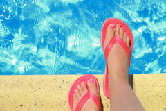 Female feet with flip flops Royalty Free Stock Images