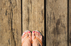 Female feet with flip-flops Royalty Free Stock Images