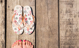 Female feet with flip-flops Stock Photography