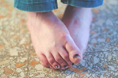 Female feet. On the floor Stock Photos
