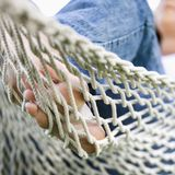 Female feet in hammock. Stock Image