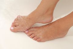 Female feet have hydrotherapeutic procedure Royalty Free Stock Images