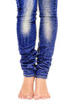 Female feet in jeans. Closeup  on white background Stock Image