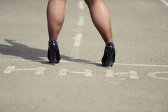 Female feet. Are lower than a knee in shoes on high heels Royalty Free Stock Photos