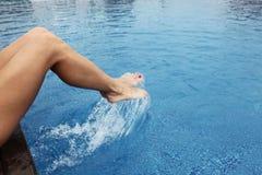 Female feet making splashes Royalty Free Stock Images