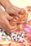 Female feet massage Stock Photos