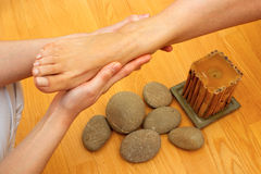 Female feet on massage spa treatment Royalty Free Stock Photo