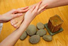 Female feet on massage spa treatment Royalty Free Stock Images